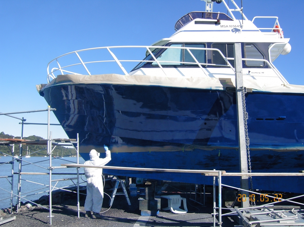 Man painting boat