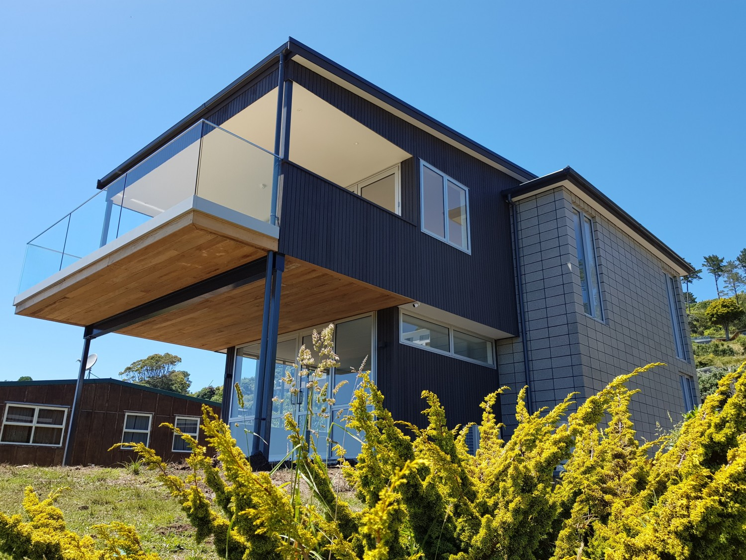 Black house with balcony deck