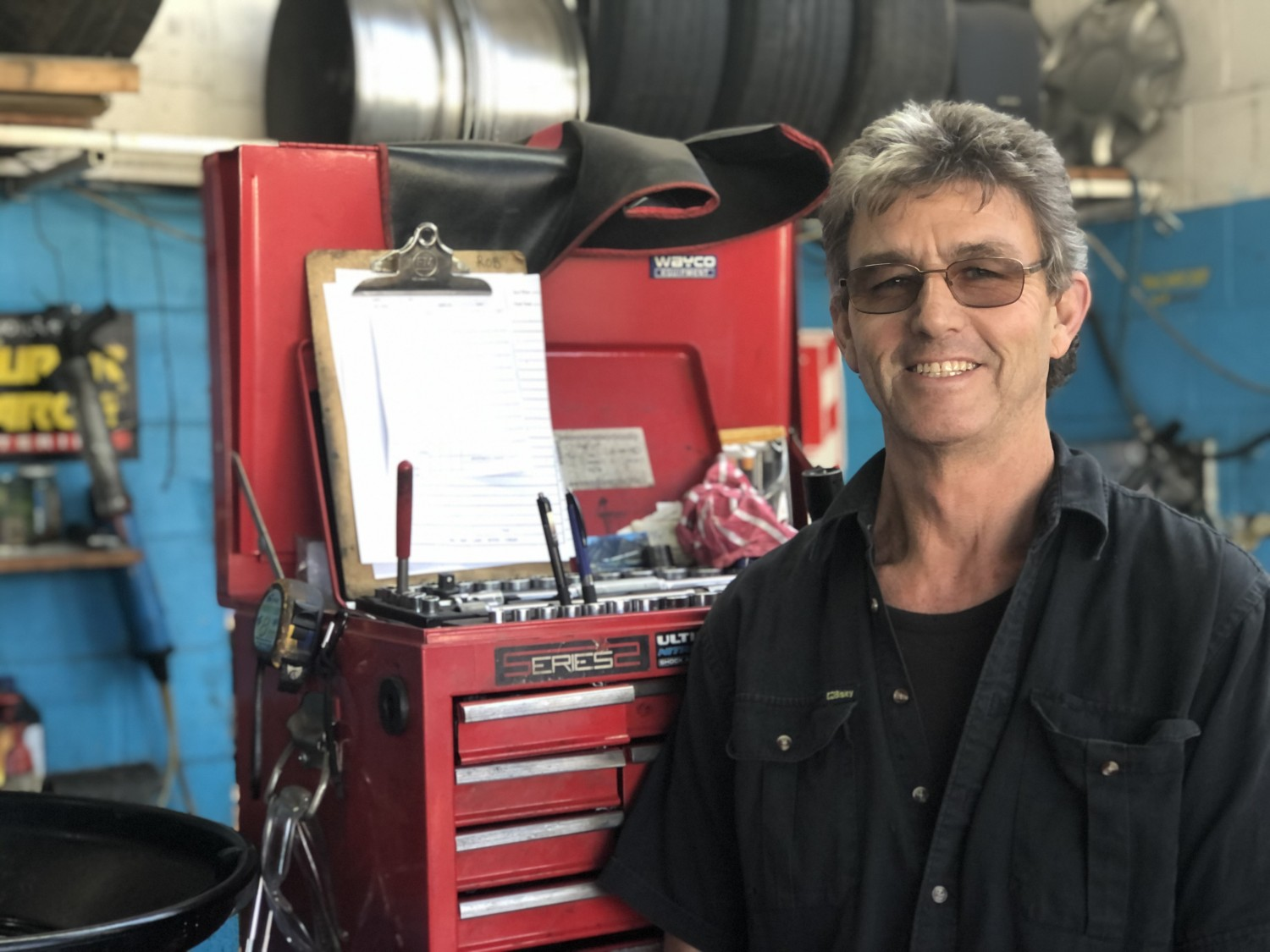 Mechanic standing in front of tool kit