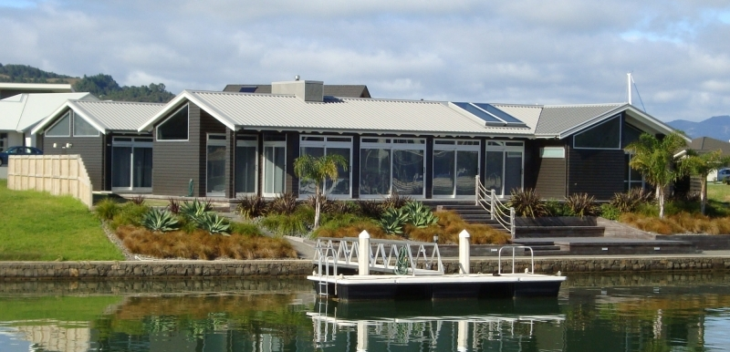House on Whitianga Waterways painted by JL Connolly Whitianga