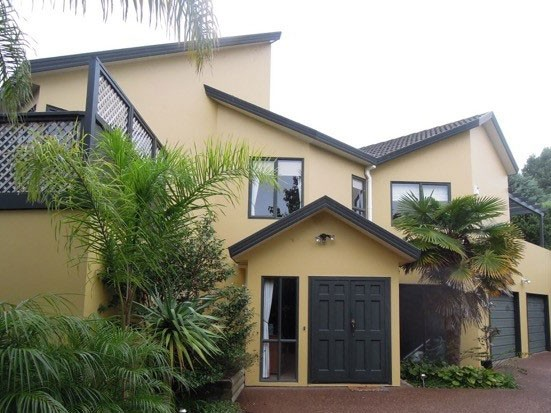 tan two storey house