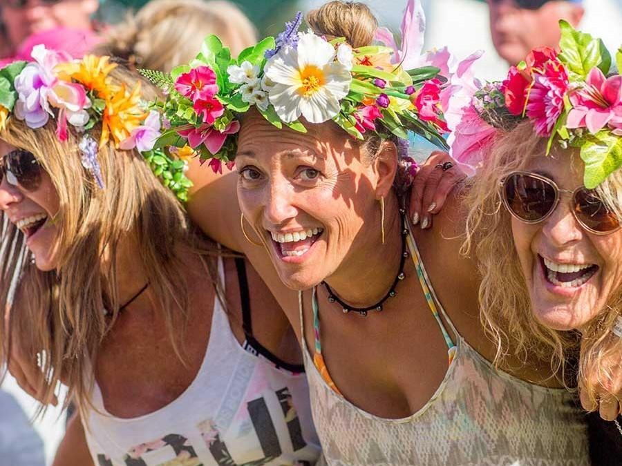 Three woman with flower headbands
