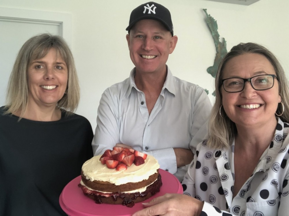 woman, man and woman holding cake