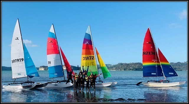 Multi hull boats with sailors at Mercury Bay Beach