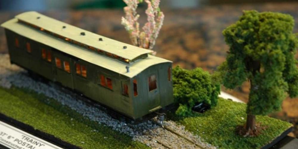 Green model train on tracks