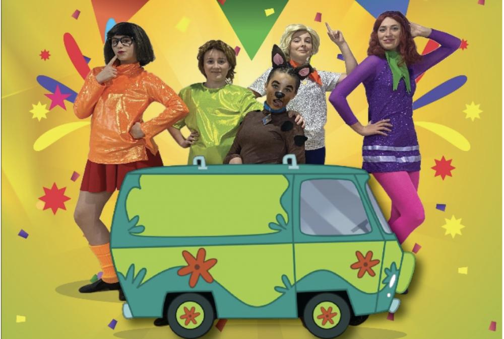Girls behind green van