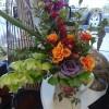 Orange and purple roses in vase