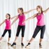 Three girls tap dancing