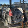 boys washing car