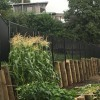 Black fence and retaining wall