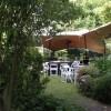 Tables under umbrellas in garden