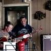 Two men playing guitars