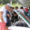 Car enthusiasts looking under the bonnet at the Leadfoot Festival Hahei