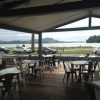 Out on the deck at Stoked in Whitianga with the fantastic view of the Mercury Bay