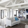 White room with couches and Tv