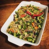 Vegetable and noodle salad in white bowl