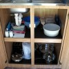 open cupboard with bowls