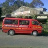 Red van parked outside building