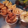 Hot wedges and chips in cups in warming cabinet