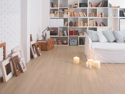 Candles on floor with sofa and bookcase