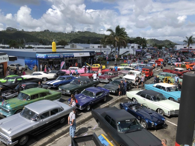 Classic cars parked in Whitianga Main Street for Beach Hop party