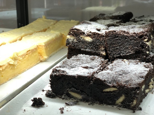 Custard squares and Chocolate brownie slices on trays