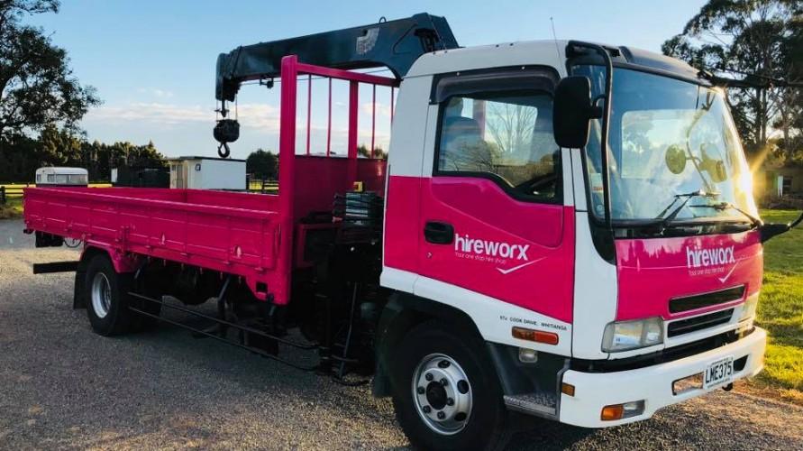 pink and white hireworx truck