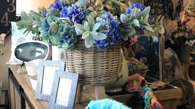Frames, basket with blue flowers on table
