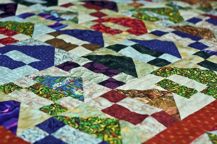 Brightly coloured quilt with geometric shapes