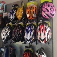 Bike helmets on wall