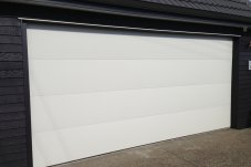 Flatline smooth color steel sectional garage door by Doors 2000 Coromandel
