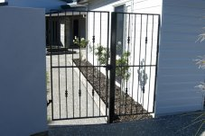 Wrought iron gates designed and manufactured by Mcarten Engineering Whitianga