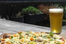 Woodfired pizza and beer in the sun at Lukes Pizza