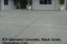 Black oxide concrete driveway with decorative cuts Coastal Concreting  Whitianga