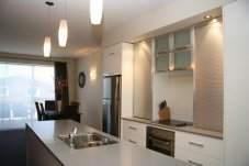 a-full-self-contained-kitchen in Ocean Resort Whitianga