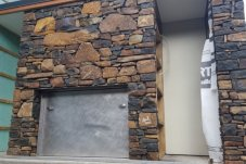 Stonework on Fireplace surround by Mark Urlich Landscaping Whitianga