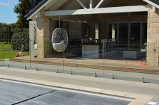 Example Glass swimming pool fence - supplier Warner