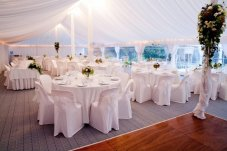 Silk linings and tables set by dance floor Peninsula Party Hire Whitianga