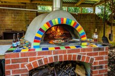 Outdoor pizza fireplace landscape Buchan Construction Whitianga