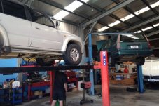 Cars on a hoists at our mechanics shop at East Coast Automotive Whitianga