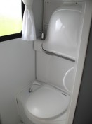 Motorhome bathroom facilities include shower, hand basin, flush toilet, and extractor fan