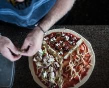 Fresh ingredients on pizzas at Lukes Kitchen