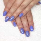 Get your light blue glitter nails done at Vogue Nails and Beauty Whitianga