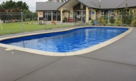 Arlington Swimming Pool. This versatile pool is both elegant and sophisticated. With its cascading curvaceous steps this pool surpasses the ordinary while offering affordable luxury. Chops Landscaping and Swimming Pools Mercury Bay