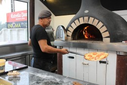 Mans cooking Pizzas at Enigma on The Esplanade