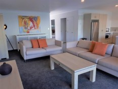 Marina Park Apartments Whitianga lounge and kitchen open plan area in appartment