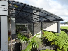 Arched AquiloGola awning system with Ziptrak blinds