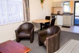 Peninsula motel dining, kitchen area studio unit Whitianga