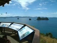 Te Whanganui-A-Hei (Cathedral Cove) Marine Reserve information panels overlooking Cathedral Cove