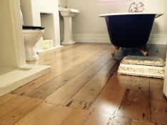 Kauri floor restoration. Owners wanted a dark tint added to enhance the Kauri timber. Coghill Cottage Whitianga.